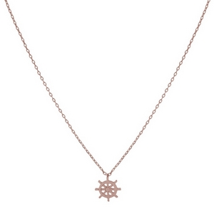 "Dainty rose gold tone necklace with a captain's wheel pendant. Approximately 14"" in length."