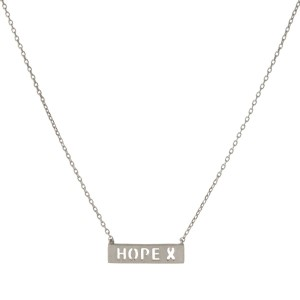 "Dainty silver tone necklace with a bar pendant stamped with ""Hope."" Approximately 14"" in length."