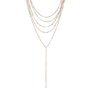 "Gold tone multilayer 'Y' necklace with pink beads. Approximately 14"" to 16"" in length."