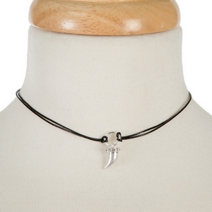 """Black waxed cord choker with a silver tone horn pendant. Approximately 12"""" in length."""