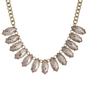 "Burnished gold tone necklace with pale pink, oval shaped rhinestones. Approximately 16"" in length."