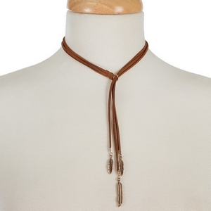 """Brown faux suede lariat choker with gold tone leaf and feather pendants. Approximately 12"""" in length."""