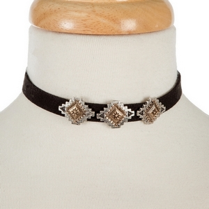 "Black faux suede choker with two tone bohemian focals. Approximately 12"" in length."