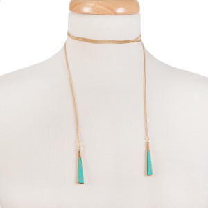 """Gold tone open wrap necklace with turquoise natural stones on the ends. Approximately 60"""" in length."""