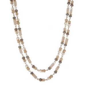 "Gold tone wrap necklace with gray and ivory beads. Approximately 60"" in length."