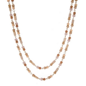 "Gold tone wrap necklace with pink, peach, and champagne beads. Approximately 60"" in length."