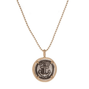 "Gold tone necklace with a two tone circle pendant stamped with ""Hope"" and displaying an anchor. Approximately 16"" in length."