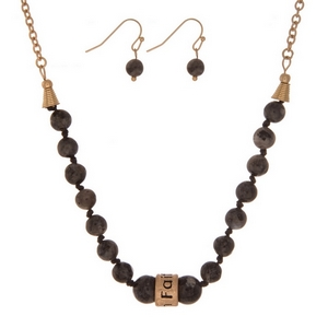 """Labradorite, natural stone beaded necklace with a gold tone bead stamped with """"Faith"""" and matching fishhook earrings."""
