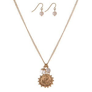 "Gold tone necklace set with an anchor charm, freshwater pearl and a clear faceted bead. Approximately 16"" in length."