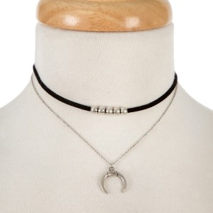 """Black faux suede choker featuring a silver tone with a crescent pendant. Approximately 12"""" and 13"""" in length."""