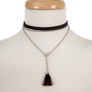 """Black faux suede layered choker with a silver tone lariat and black fabric tassel. Approximately 12"""" and 14"""" in length."""
