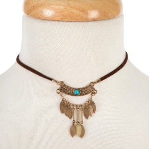 """Brown faux suede choker with a gold tone and turquoise beaded bohemian pendant. Approximately 12"""" in length."""