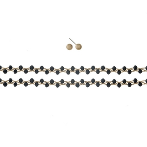 """Gold tone, wire wrapped, two layer black beaded choker with matching stud earrings. Approximately 12"""" in length."""