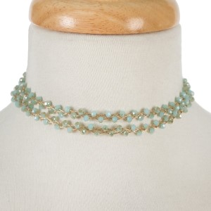 """Gold tone, wire wrapped, two layer mint beaded choker with matching stud earrings. Approximately 12"""" in length."""