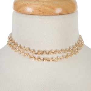 """Gold tone, wire wrapped, two layer ivory beaded choker with matching stud earrings. Approximately 12"""" in length."""