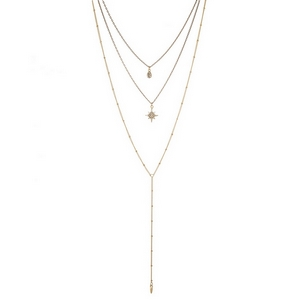 """Dainty gold tone three layer necklace with star and clear rhinestone pendants. Approximately 14"""" to 24"""" in length."""
