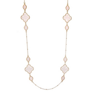 "Gold tone necklace with light pink beaded clover stationaries. Approximately 32"" in length."