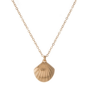 "Dainty gold tone necklace featuring a small seashell pendant. Pendant is approximately 7mm. Length adjusts from 16""-18""."