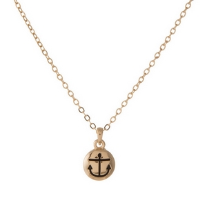 "Dainty gold tone necklace featuring a small polished pendant that has an anchor stamped inside. Pendant is approximately 7mm. Length adjusts from 16""-18""."