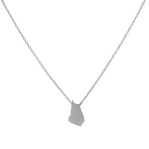 "Dainty silver tone necklace featuring a brushed Georgia shaped pendant. Pendant approximately 7mm in length. Length adjusts from 16""-18""."