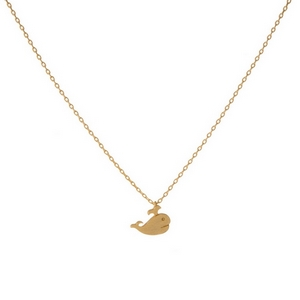 """Dainty gold tone necklace with a small whale pendant. Pendant is approximately 7mm. Length adjusts from 16""""-18""""."""