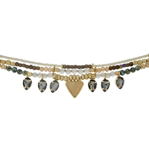 """Gold tone choker featuring peach, green and opal stones and gray rhinestones. Approximately 12"""" in length."""