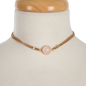 "Tan faux suede choker featuring a rose quartz focal and gold tone stud earrings. Approximately 12"" in length."