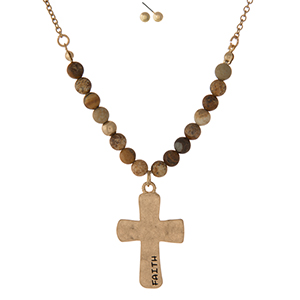 "Gold tone necklace set displaying a cross pendant, stamped with ""Faith"" and accented with picture jasper natural stone beads. Approximately 16"" in length."