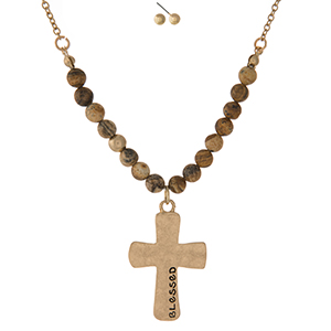 "Gold tone necklace set displaying a cross pendant, stamped with ""Blessed"" and accented with picture jasper natural stone beads. Approximately 16"" in length."