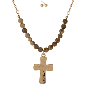 "Gold tone necklace set displaying a cross pendant, stamped with ""Believe"" and accented with picture jasper natural stone beads. Approximately 16"" in length."