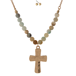 "Gold tone necklace set displaying a cross pendant, stamped with ""Believe"" and accented with amazonite natural stone beads. Approximately 16"" in length."