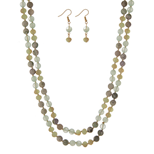 """Light green natural stone beaded wrap necklace with matching fishhook earrings. Approximately 60"""" in length."""