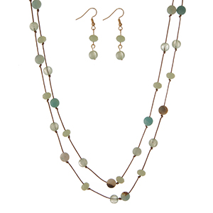 "Brown cord wrap necklace featuring knotted amazonite natural stone beads and matching fishhook earrings. Approximately 72"" in length."