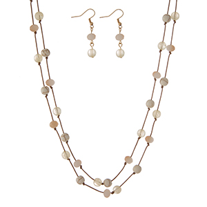 "Brown cord wrap necklace featuring knotted ivory natural stone beads and matching fishhook earrings. Approximately 72"" in length."