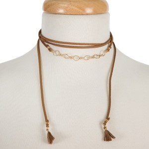 """Brown, faux leather wrap necklace with gold tone circles and fabric tassels on the ends. Approximately 60"""" in length."""