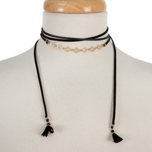 """Black, faux leather wrap necklace with gold tone crosses and fabric tassels on the ends. Approximately 60"""" in length."""