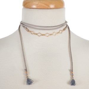"""Gray, faux leather wrap necklace with gold tone diamond shapes and fabric tassels on the ends. Approximately 60"""" in length."""