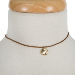 """Brown faux leather cord choker with a gold tone disc pendant. Approximately 12"""" in length."""