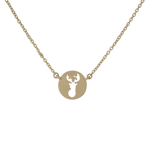 "Dainty gold tone necklace with a circle pendant displaying the cutout of a deer head. Approximately 16"" in length."
