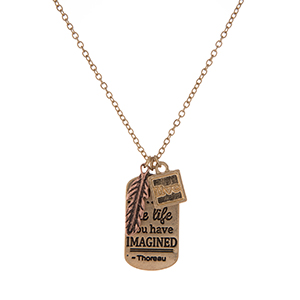 "Dainty gold tone necklace featuring a pendant stamped with ""Live the life you have imagined"" and accented with two small charms. Approximately 16"" in length."