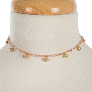 """Pale pink beaded choker with clear rhinestone accents. Approximately 12"""" in length."""