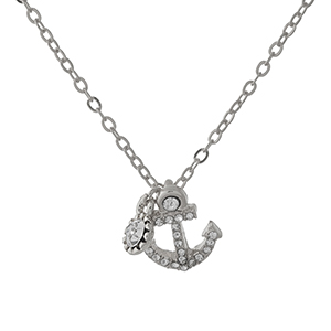 "Dainty silver tone necklace with an anchor pendant. Approximately 16"" in length."