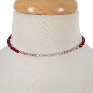 """Gold tone memory wire choker featuring burgundy, gray and lavender faceted beads. Approximately 5"""" in diameter with a 3"""" extender."""