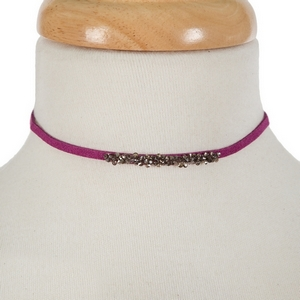 "Purple faux suede choker with hematite and gray stones. Approximately 12"" in length."