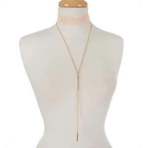 """Blush pink crocheted choker set with a gold tone 'Y' necklace accented with clear rhinestones. Choker is approximately 12"""" in length and necklace is 24"""" in length."""