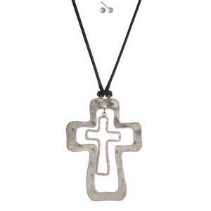 """Black cord necklace set with a hammered silver tone cross pendant. Necklace is approximately 34"""" in length and pendant is 4"""" in length."""
