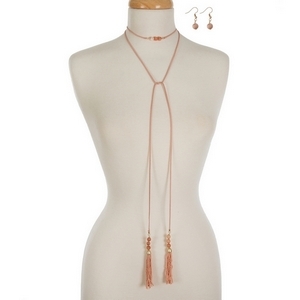 """Peach faux suede wrap necklace featuring peach beaded tassels on each end and matching fishhook earrings. Approximately 60"""" in length."""
