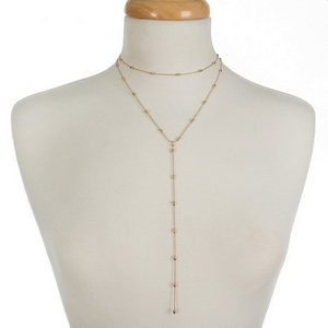 """Dainty two layer, gold tone necklace featuring a choker layer and a 'Y' layer. Approximately 12"""" and 16"""" in length."""