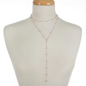 """Dainty two layer, rose gold tone necklace featuring a choker layer and a 'Y' layer. Approximately 12"""" and 16"""" in length."""