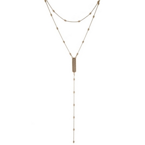 """Dainty gold tone two layer necklace displaying a mother of pearl stone on the 'Y' layer. Approximately 12"""" and 17"""" in length."""